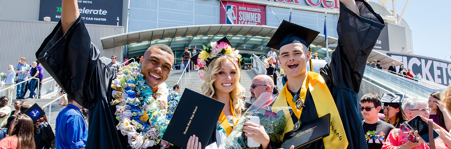 Three Nevada State High School students at their graduation