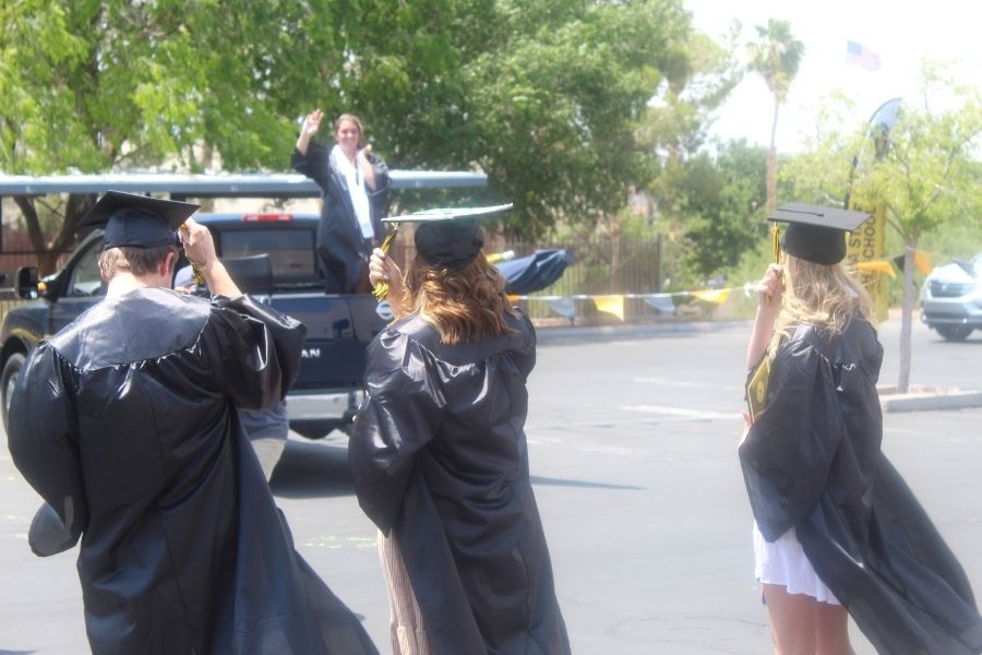 NSHS students celebrating at a drive thru graduation ceremony